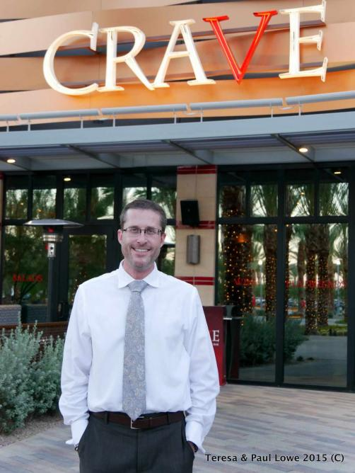 Manager Ryun Chastain standing outside of Crave.