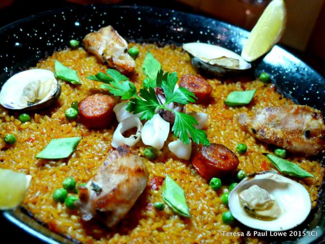 The must-try house specialty paella is brimming with incredible flavors.