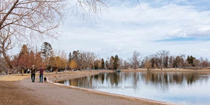 A duo takes a stroll around the lake at Washington Park.