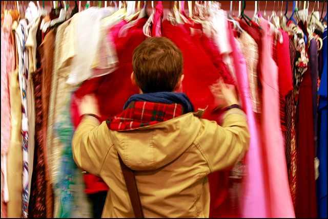 Jen attacks a vintage clothes rack|©Joseph Brent/ Flickr