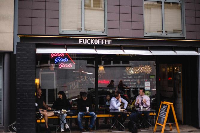 Outside Fuckoffee with people chatting