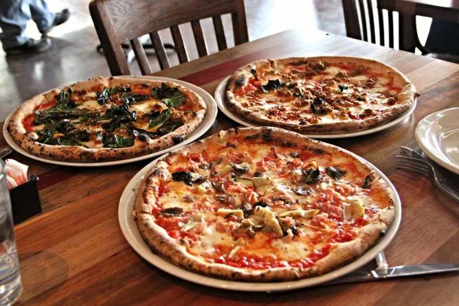 Three different specialty pies at Cana Rosso in Dallas, Texas.