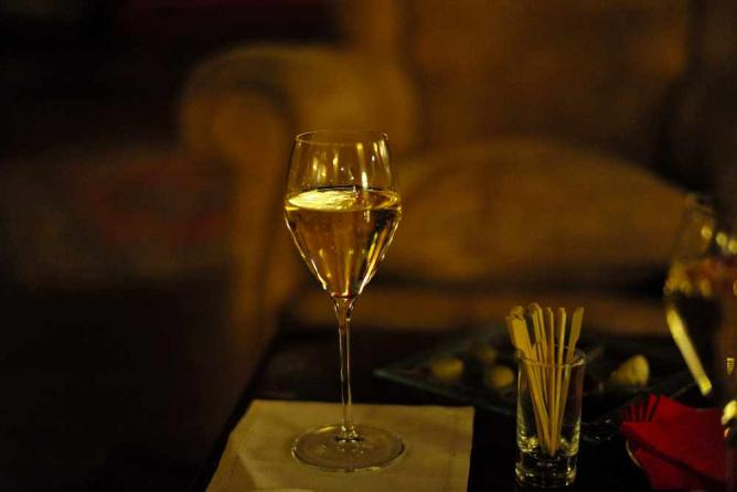 A photo of a glass of white wine