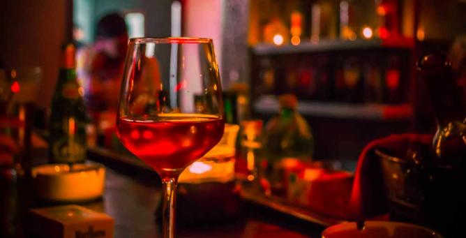 A glass of wine at the bar
