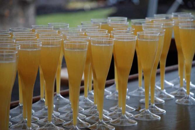 A photo of mimosas at the bar