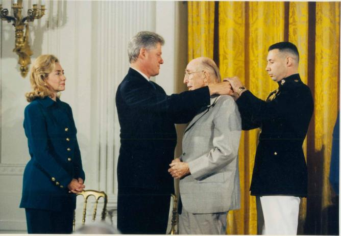 Bill and Hillary Clinton photo with James Rouse | White House photo