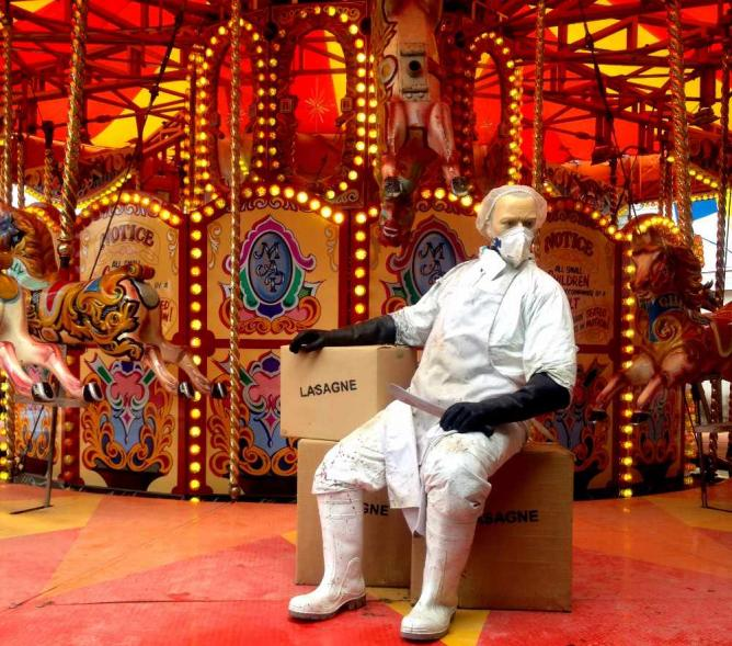 A carousel hijacked by abattoir workers and crates labelled 'lasagne'   Courtesy of Marianna Hunt
