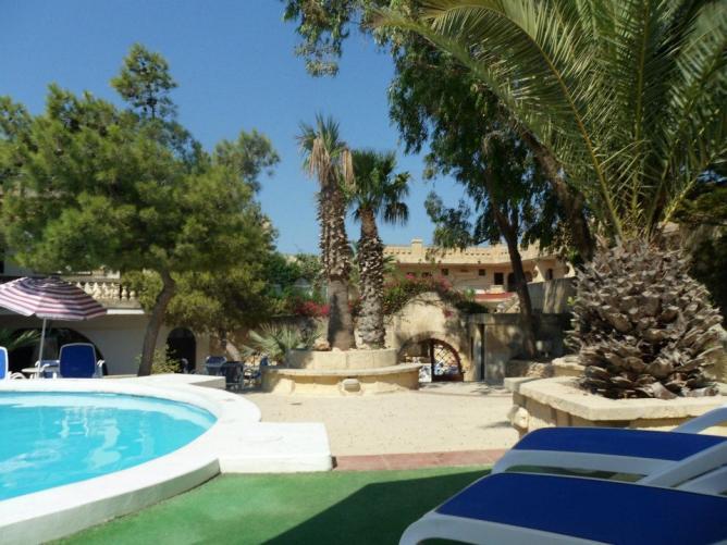 Pool area at Cornucopia Hotel