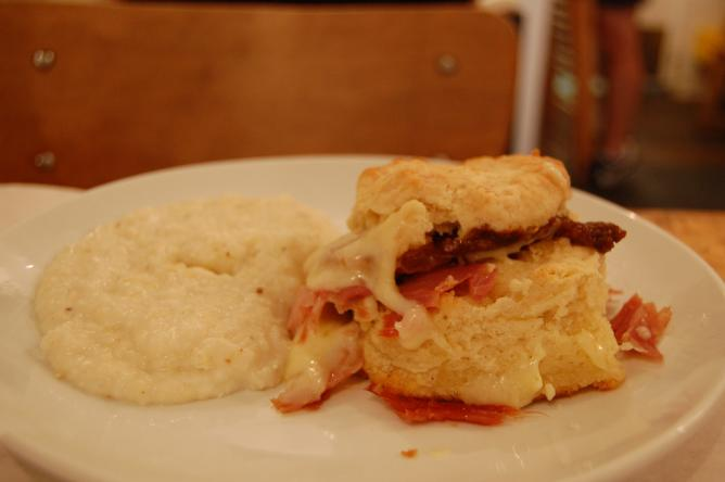 Breakfast with biscuits, bacon and grits
