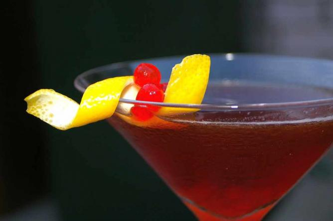 Rum Manhattan with Maraschino Caviar and a twist of lemon | © My Aching Head/Flickr