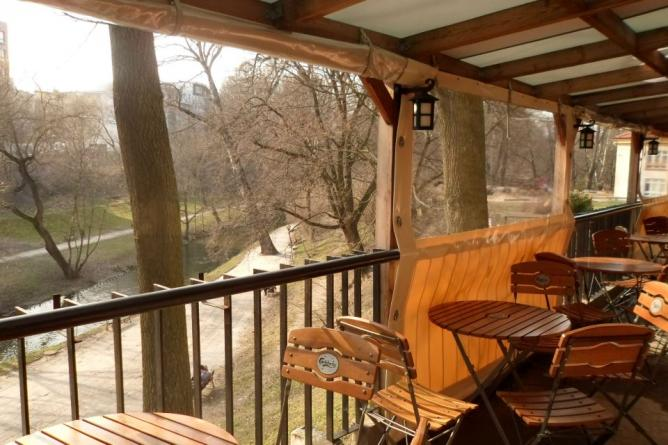 Outdoor Patio overlooking the Łyna river | © Courtesy of Sznaps