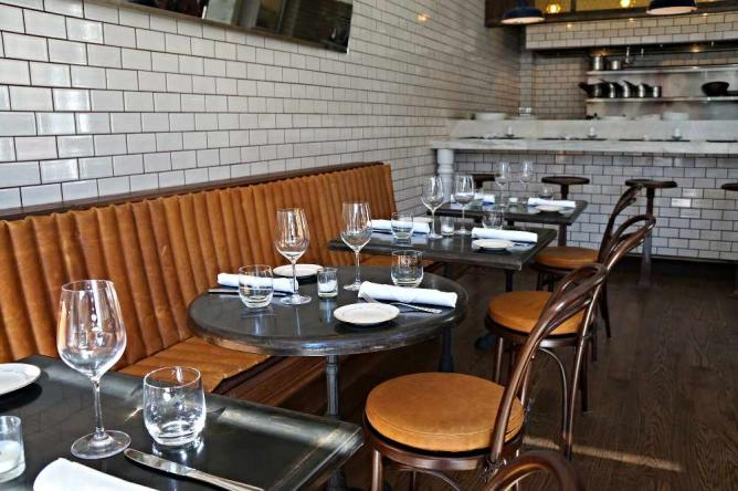 The interior at Filter Dining Room offers bright and dim lighting with an open kitchen.