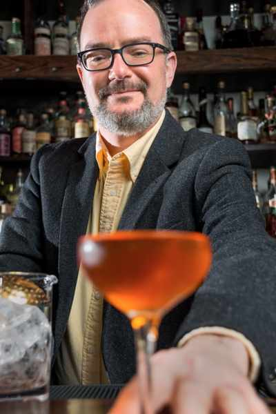 Author Paul Clarke mixes another perfect drink | © Photography by Ari Shapiro