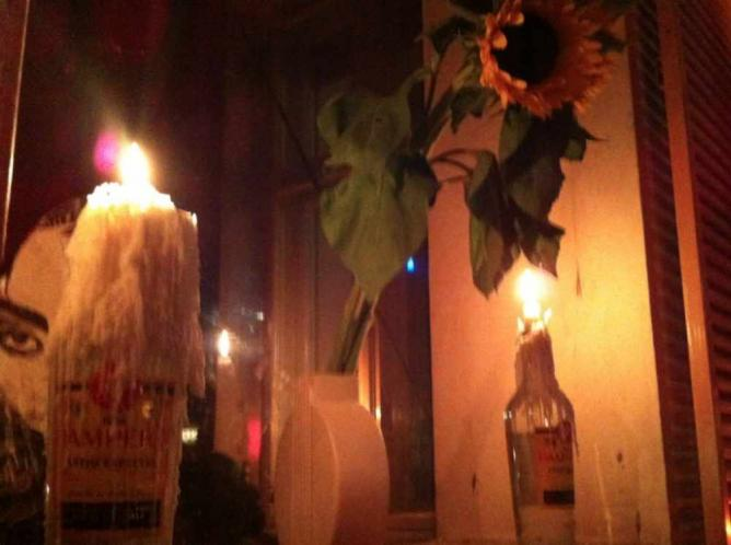 Candles in recycled bottles, Berlin | © Adriana Tourny