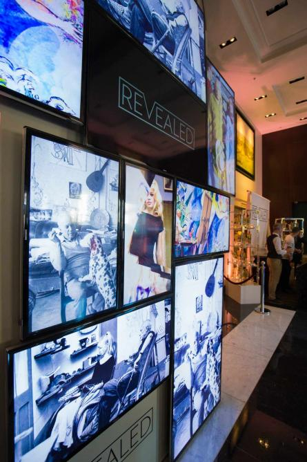 The exhibition also features multiple screens showcasing the art | © Revealed: A Photography Exhibition by Sofitel