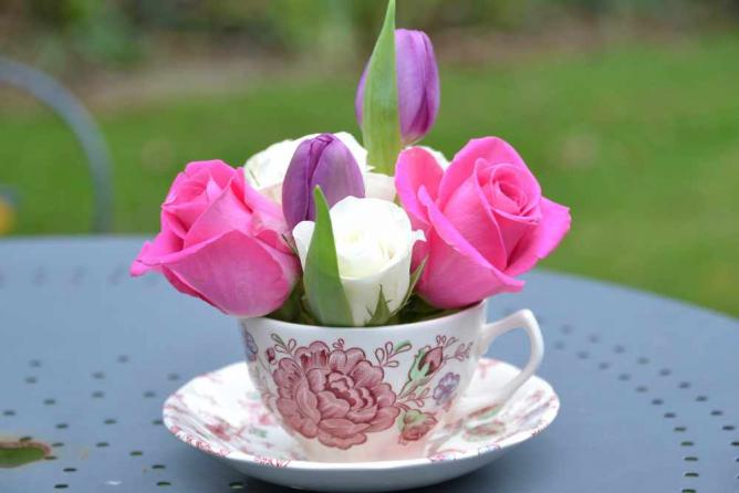 Flowers in a cup © jeffdjevdet/Flickr and Speed Property Buyers