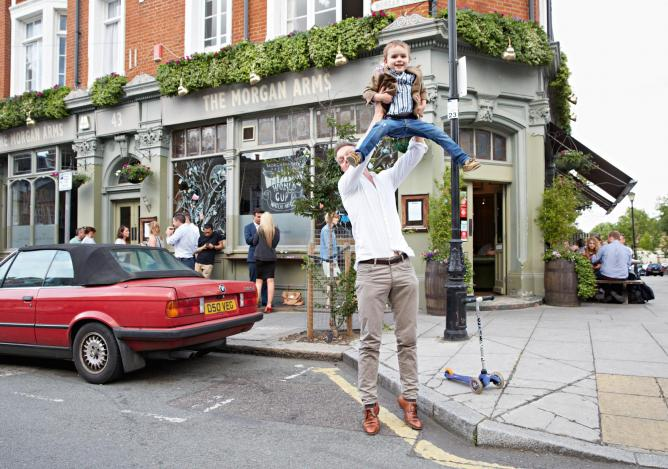 Marlow and his son George at The Morgan Arms in Mile End. Father and son go to the pub for apple juice and chips every Friday. Photograph by Robin Friend © Transglobe Publishing