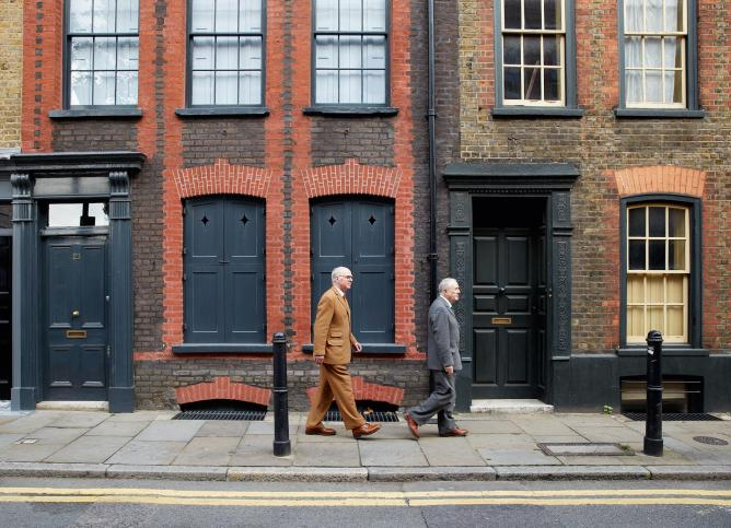 Gilbert & George on Fournier Street. Photograph by Robin Friend © Transglobe Publishing