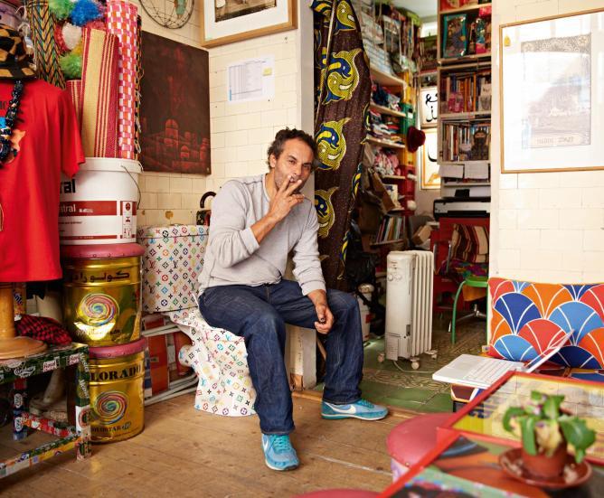 Hassan Hajjaj at his shop near Arnold Circus. Photograph by Robin Friend © Transglobe Publishing