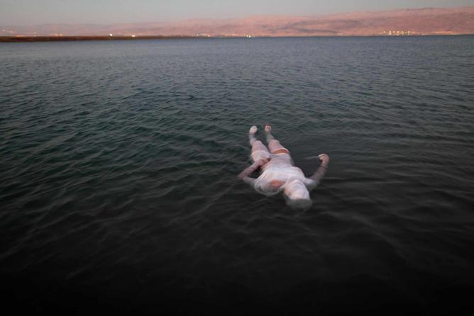 Ariane Littman, Sea of Death 2010,Performance at the Dead Sea, video, Photograph Jim Hollander | © Ariane Littman and Jim Hollander