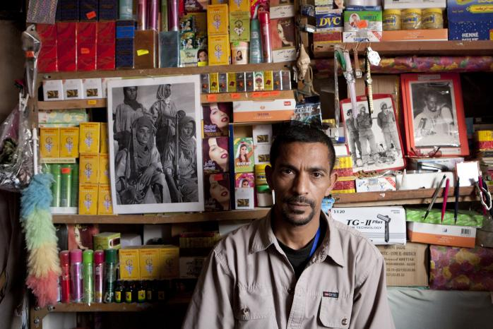 'Man in a shop'. 'Africa's Last Colony: 40 Years Not Forgotten' / Courtesy of Hundred Years Gallery
