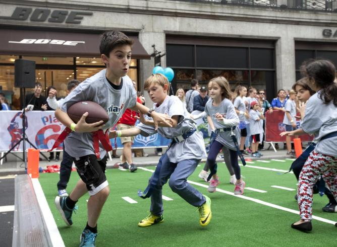 Children playing American Football | Courtesy of Dave Parry, Press Association