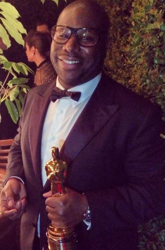 Steve McQueen holding Best Picture Oscar. March 2, 2014.