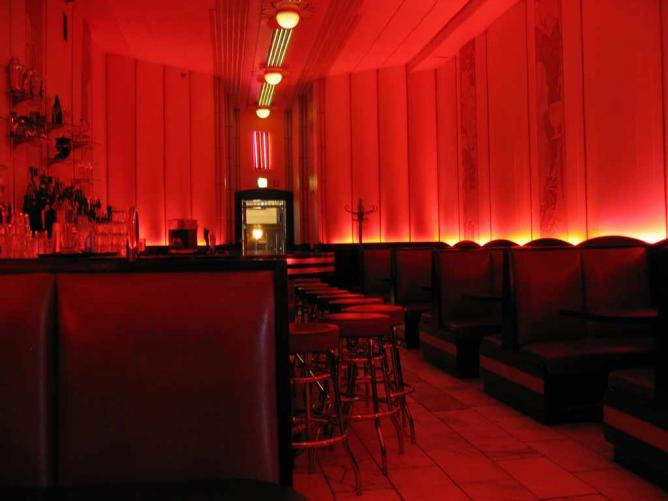 The interior of the red hued Cooper Lounge.