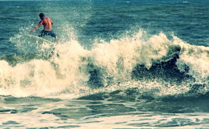 A surfer on the waves in Atlantic City.