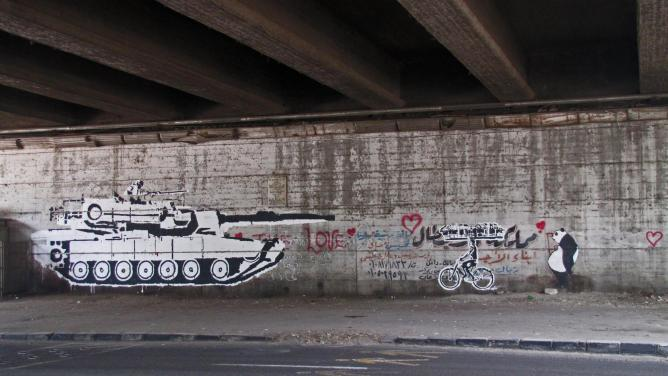 Tank vs Biker   © Ganzeer