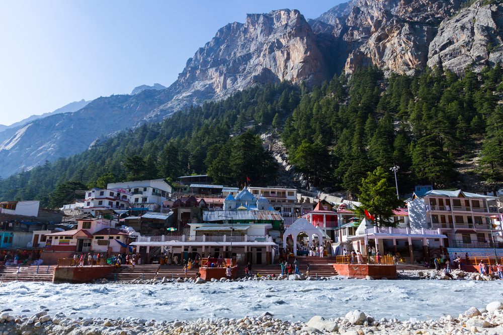 The temple town of Gangotri in the Indian Himalayas near the source of the sacred river Ganges| © Nila Newsom/Shutterstock