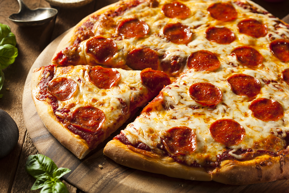Hot Homemade Pepperoni Pizza Ready to Eat © Brent Hofacker / Shutterstock