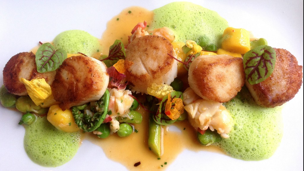 Seared day boat scallops with saffron gnocchi, poached lobster, and early Spring vegetables at Troquet | ©Dale Cruse/Flickr