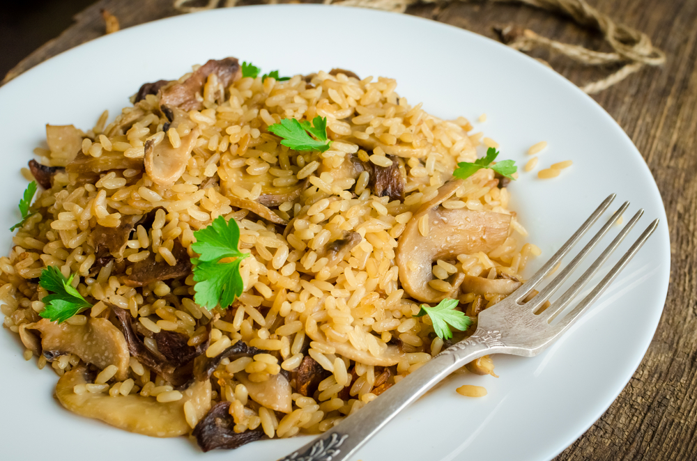Classic Risotto with Wild mushrooms risotto with parsley © Nelli Syrotynska / Shutterstock