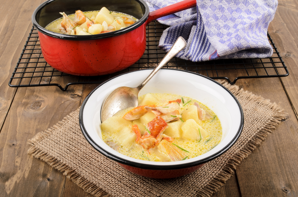 Cullen skink, typical scottish food with smoked haddock in a pot and bowl on jute © Joerg Beuge / Shutterstock