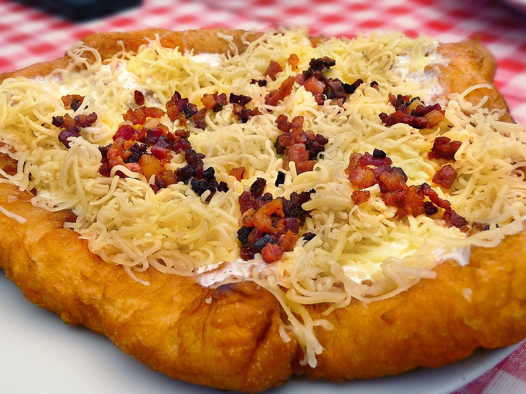 Lángos (deriving from the word flame) is served as a satisfying alternative to bread © FrugalGlutton.com / Flickr