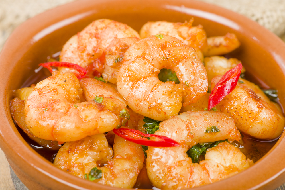 Gambas Pil Pil (Sizzling prawns with chili and garlic). © Paul_Brighton / Shutterstock