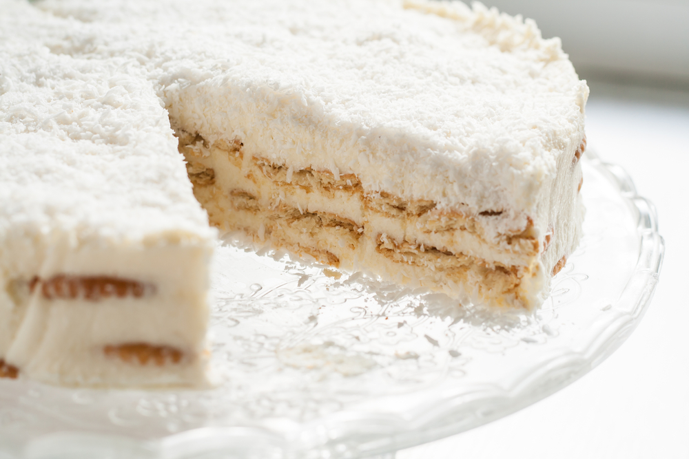 On a piece of coconut cake plate © TanaCh / Shutterstock