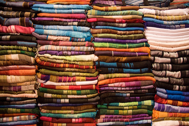 Colourful fabrics at the souk © Martin and Kathy Dady/Flickr