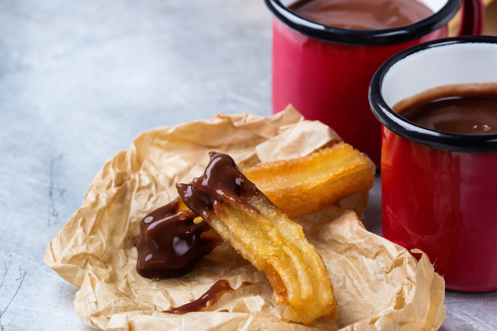 Traditional spanish churros with hot chocolate in a mug |©Antonina Vlasova/Shutterstock