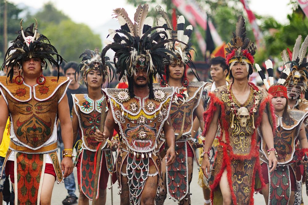 Dayak of Kalimantan in Cap Gomeh celebration in Singkawang province. © Muslianshah Masrie / Shutterstock