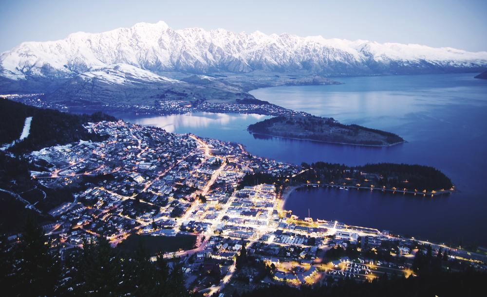 Mountain Cityscape Lake Beautiful Travel Destinations Concept ©Rawpixel / Shutterstock