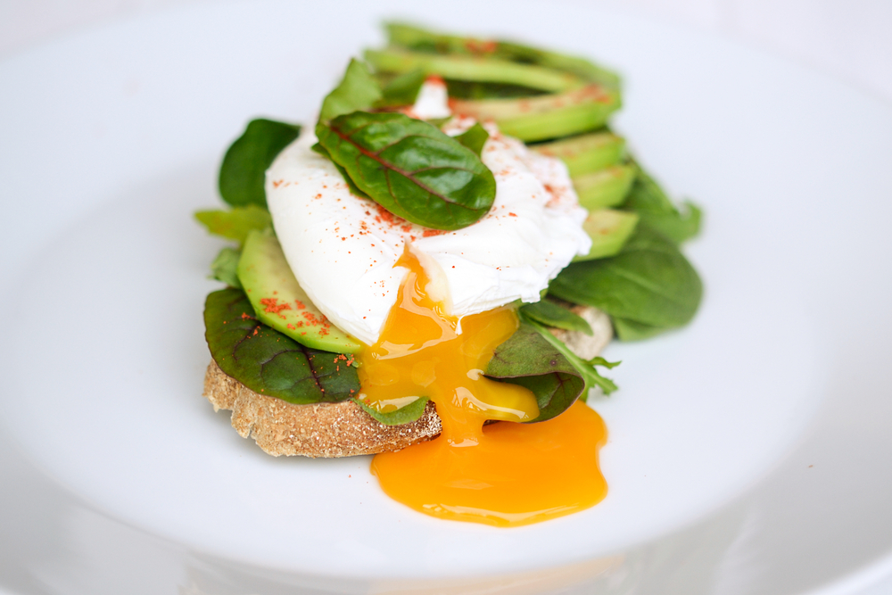 Breakfast with Wholemeal Bread Toast and Poached Egg with Green Salad, Avocado © kopava / Shutterstock