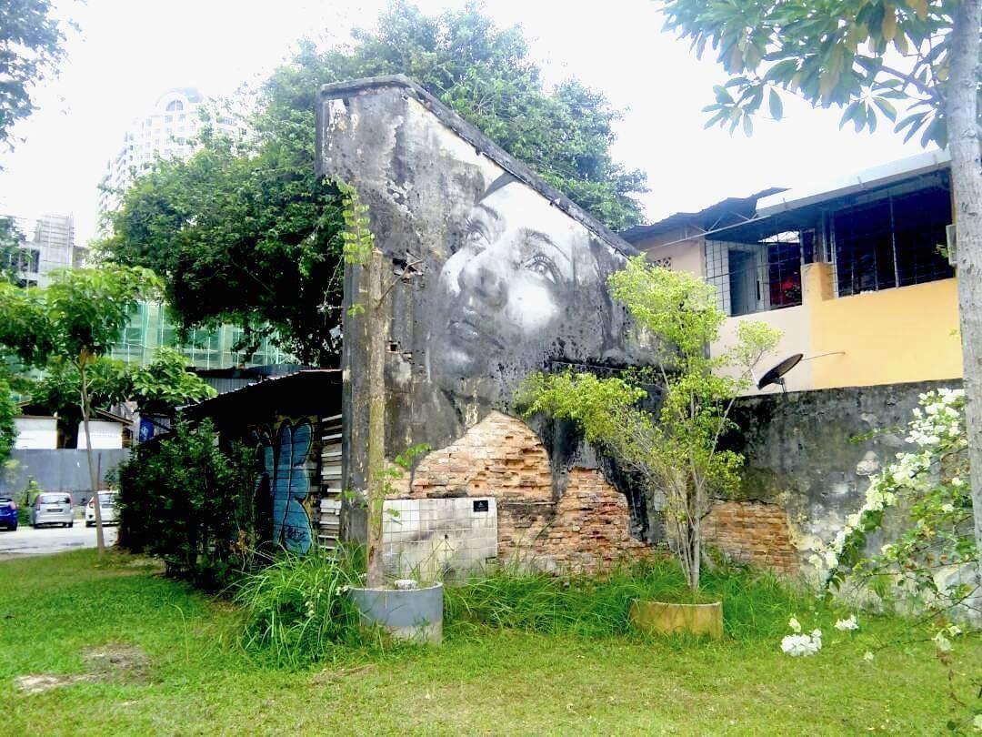 Culture Trip - Penang street art - thoughtful woman
