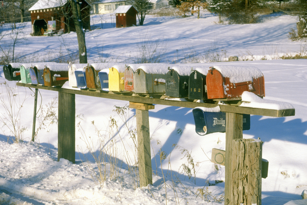 Row of residential mailboxes at winter in rural Woodstock, NY © Joseph Sohm / Shutterstock
