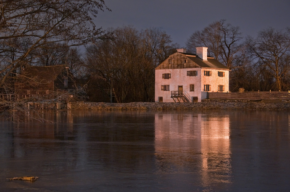 18th century Philipsburg Manor reflecting off the frozen pond. Sleepy Hollow NY © Jeffrey T. Kreulen / Shutterstock