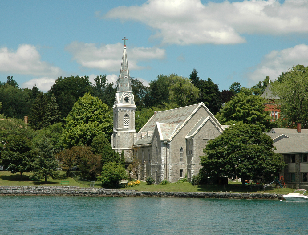 Lake front Church with Steeple and clock tower. Skaneateles Lake, Finger Lakes Region, Upstate New York ©  Brett Rabideau / Shutterstock