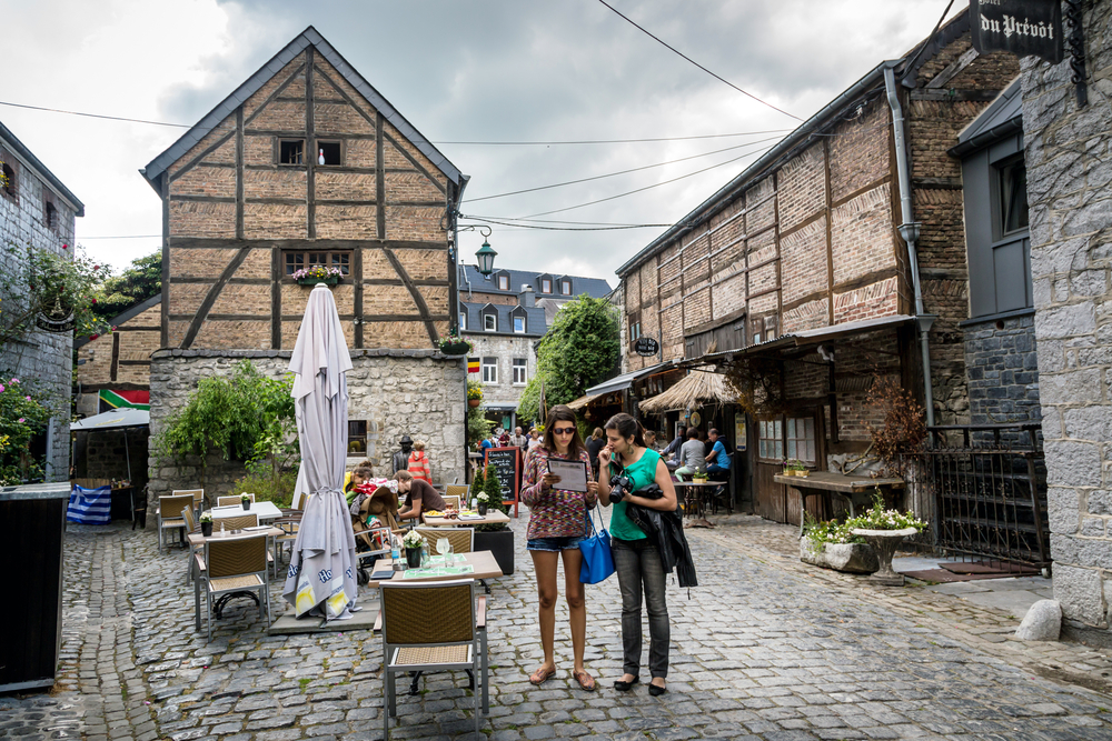 Tourists and locals enjoys the old village of Durbuy in a cloudy hot day. Belgium © LMspencer / Shutterstock