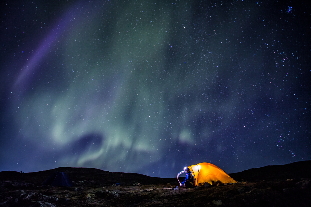 Camp, tent and Northern Lights in Lapland - Sweden © Jens Ottoson / Shutterstock