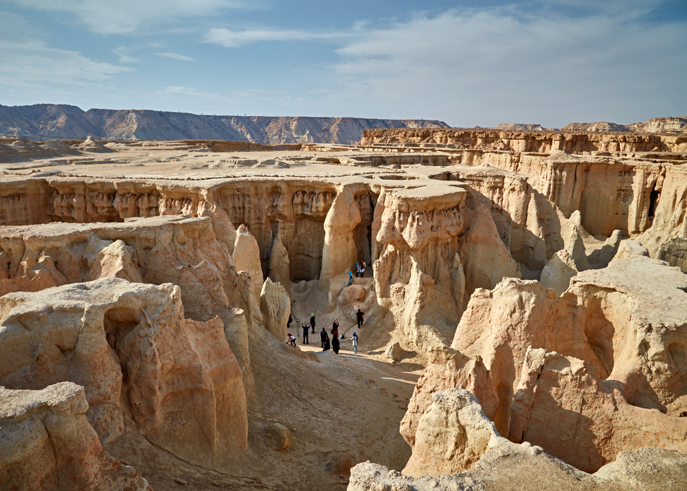 People walking through Stars Valley. Mountain range at Qeshm Island, Iran | © SJ Travel Photo and Video/Shutterstock